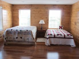 Upstairs bedroom# 1 in new addition has 3 beds