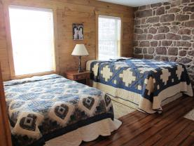 Upstairs bedroom #2 in new addition has 3 beds      1 Queen, 1 Double, & 1 Twin
