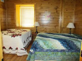 Bedroom #2 on main floor also has 2 beds   2 Doubles